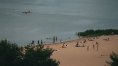 People on the beach on a sunny summer day. long shot Stock Footage