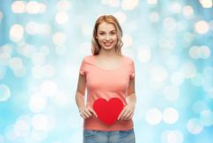 happy woman or teen girl with red heart shape - stock photo