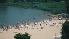 people on the beach on a sunny summer day. long shot - stock footage
