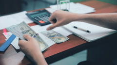Man hands counting money US dollars on his workplace in office - stock footage