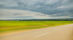 Walk along the road against the background of cloud stream. Time lapse.Hyperlaps - stock footage