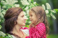 Mother and daughter in summer park - stock photo