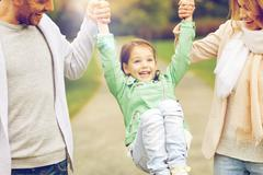 happy family walking in summer park and having fun - stock photo