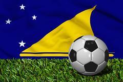 Soccer Ball on Grass with Tokelau Flag Background, 3D Rendering Stock Illustration