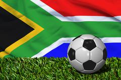 Soccer Ball on Grass with South Africa Flag Background, 3D Rendering Stock Illustration