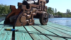 Sword and canon on river wharf tilt Stock Footage