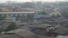 House and slum area on a rainy day in thailand Stock Footage