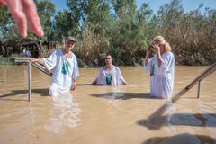 Jericho, Israel - November 2, 2015: Organized baptism for group of pilgrims i - stock photo