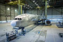 Refurbishment of an airplane. Grinding and painting. - stock photo