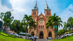 Tourists visit the famous Notre-Dame Cathedral in Ho Chi Minh City Stock Footage