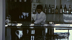 France 1968: man preparing a drink in a bar - stock footage