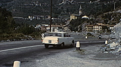 France 1968: traffic in a mountain street in the Alps - stock footage