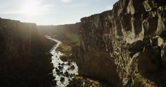 River in a beautiful canyon at sunset camera crane landscape shot Stock Footage