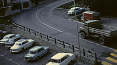 France 1968: traffic in a mountain street in the Alps Stock Footage