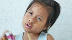 Little girl was shaken bottle color. - stock footage