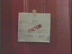 Rear view of woman removing eviction notice from door, 1980s Stock Footage
