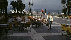Lake Garda 1968: people walking by the lake - stock footage