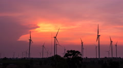 Time lapse - Wind turbine power generator at twilight-pan L - stock footage