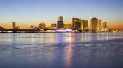 Skyline of New Orleans Across the Mississippi River - Time Lapse - stock footage
