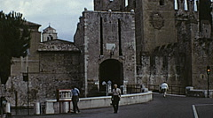 Sirmione, Italy 1968: people walking in front of the castle Stock Footage