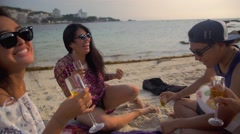 Fun group of friends playing drinking champaign together on the beach side Stock Footage