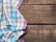 Table cloth on a wooden table - stock photo
