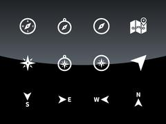 Compass icons on black background - stock illustration