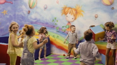 children play in the playroom - stock footage