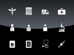 Hospital icons on black background - stock illustration