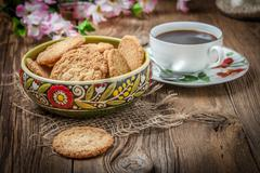 Stack of freshly baked oat biscuits in a bowl. - stock photo