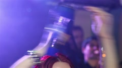 Singer beat with hands overhead in a tambourine, during the concert of pop music Stock Footage