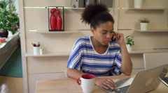 Young professional mixed race businesswoman working in the modern office Stock Footage