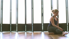 Beautiful young woman doing seated yoga medium shot Stock Footage