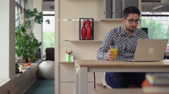 Man working in modern contemporary office - stock footage