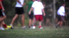 Men playing soccer on the sports field of university campus Stock Footage