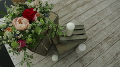 Wedding decorations with flowers on wooden boxes Stock Footage