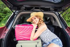 Woman on vacation. Summer holiday and car travel concept Stock Photos