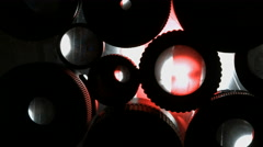 Many eyes of the lens. Multiple camera lenses with light from the back. Blackmag - stock footage