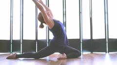 Wonderful young woman doing yoga in a studio medium shot Stock Footage