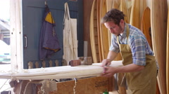 Man Shaping Custom Surfboard In Workshop Shot On RED Camera Stock Footage