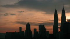 Stop motion. Sunrise in Kuala Lumpur with the silhouette of the Kuala Lumpur Stock Footage