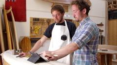 Carpenter In Workshop With Digital Tablet Shot On RED Camera Stock Footage