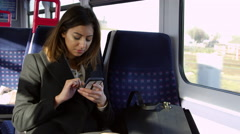 Businesswoman Reading Text Message On Train Shot On R3D Stock Footage