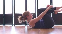 Beautiful woman doing yoga in a studio medium shot Stock Footage