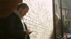Man Making Mobile Phone Call On Way To Work Shot On R3D Stock Footage