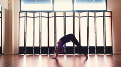 young woman stretching doing yoga medium shot Stock Footage