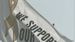 We Support Our Troops Flag Waving in Slow Motion Stock Footage