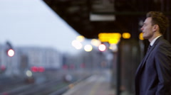 Businessman On Platform Waiting For Train Shot On R3D Stock Footage