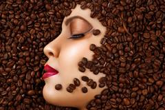 Beauty profile face with makeup in coffee beans Stock Photos