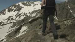Hiker traveling in the mountains. Blackmagic 4k Stock Footage
